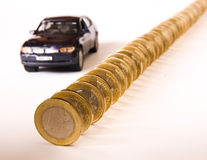 Price of car. Queue of euro coins  and car, conceptual image Royalty Free Stock Photo