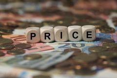 Price - cube with letters, money sector terms - sign with wooden cubes Royalty Free Stock Images