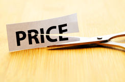 Price cut. With scissor , financial concept stock photography