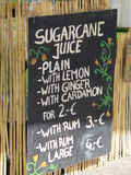 Price List. Traditional blackboard or A-board advertising freshly made sugar cane drinks stock images