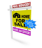 Price Reduced - Home for Sale Sign. A for sale sign with several additional markings on it representing the desperation of a seller Stock Photos