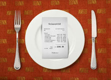 The price at restaurant. The bill on empty plate at restaurant Royalty Free Stock Photos