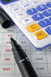 Price sheet, account pen and calculator. An account pen and a calculator put on a price sheet, means business, finance, maket, numbers, statistic, and Royalty Free Stock Photos
