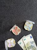 Low cost makeup, eye shadows and euro banknotes, view from above. Price of shopping and offer, fashion and beauty for women, services and treatments of a beauty royalty free stock photography