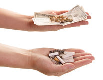 Price smoking. Cigarette butts and money in hands. Isolated on white background Royalty Free Stock Photo