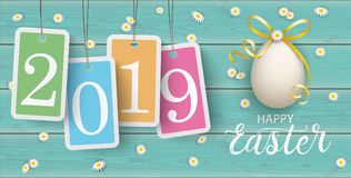 Happy Easter Eggs Daisy Wooden Price Stickers Turquoise 2019 Hea. Price stickers 2019 with daisy flowers and easter egg on the wooden background Stock Photos