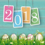 Easter Eggs Cyan Wood Pastel Price Stickers 2018. Price stickers 2018 on the wooden background with easter eggs in the grass Stock Image