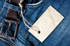 Price tag. Blue jeans with price tag Royalty Free Stock Image