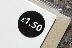 Price tag. A close up of a £1.50 price tag sticker Stock Photos