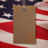 Price tag on American flag background Stock Photos