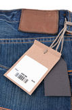 Price tag with barcode on  jeans Royalty Free Stock Photos