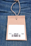 Price tag with barcode on  jeans Royalty Free Stock Image