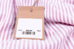 Price tag with barcode on shirt Stock Photography