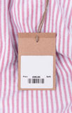 Price tag with barcode on shirt Stock Photo