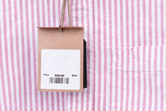 Price tag with barcode on shirt Stock Images