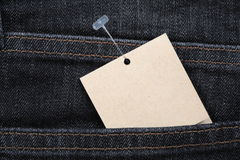 Price tag  and blue jeans Stock Images