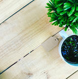 Price tag of brown and black coffee and plant in pot. On wooden table. top view. copy space Royalty Free Stock Photos