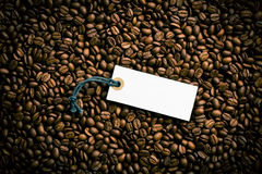 Price tag on coffee beans. Top view of price tag on coffee beans Stock Images
