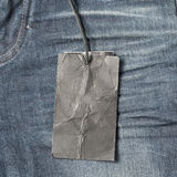 Price tag on jean. Clothing and accessories Royalty Free Stock Photos