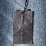 Price tag on jean. Clothing and accessories Royalty Free Stock Photo
