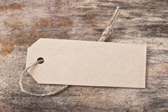 Price tag label. On wooden background Stock Photos