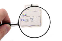 Price tag and magnifier Stock Image