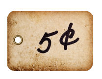 Price Tag with Metal Grommet. A grungy 5 cent tag with a metal grommet isolated against a white background Stock Photos
