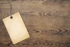 Price tag on old wooden table background Stock Images