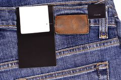 Price tag over jeans Royalty Free Stock Photos