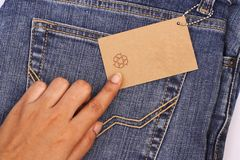 Price tag over jeans Stock Photo