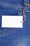 Price tag over jeans textured pocket Royalty Free Stock Photos