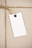 Price tag over parcel wrapped Royalty Free Stock Image