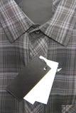 Price tag of Plaid shirts Stock Photos