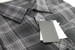 Price tag of Plaid shirts Royalty Free Stock Image