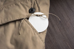 Price Tag, in the pocket of a jacket beige winter Stock Photos
