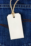 Price tag from recycled paper on twine cord on jean Royalty Free Stock Photo