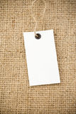 Price tag and sack burlap background Stock Photo