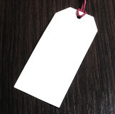 Price tag on wooden background.Blank tag.Discounts. Benefit. marketing concept Stock Images