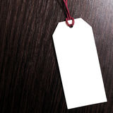 Price tag on wooden background.Blank tag.Discounts. Benefit. marketing concept Stock Photos