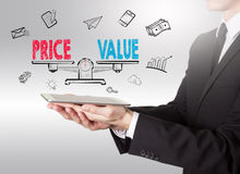 Price and Value Balance, young man holding a tablet computer Stock Photos