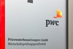 Price Waterhouse Coopers or PwC office building in Berlin, Germany. Pricewaterhouse Coopers Gmbh or PwC logo outdoors. PwC ranks as the second largest stock image