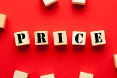 Price Word Concept. Price word written on cubes shape wooden blocks on red background. Business Concept stock images