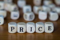 Price written with wooden cubes. Block stock photos