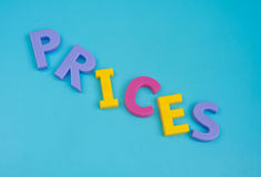 Prices tumbling down. ' Prices tumbling down ' illustrated in colorful upper case letters on a pale blue background, concept of deflation Stock Photos