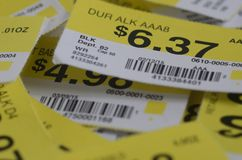 Prices. Yellow and white retail store shelf price tags Royalty Free Stock Image