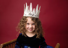 Pricess Pretend Play: Happy Girl in a Crown on Christmas Red Stock Photos