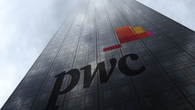 PricewaterhouseCoopers PwC logo on a skyscraper facade reflecting clouds. Editorial 3D rendering Royalty Free Stock Photos