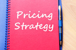 Pricing strategy write on notebook Stock Photography