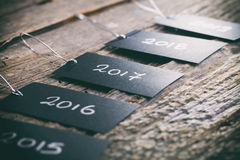 Pricing tags in a row with. 2017 focus and other years text on wooden background Royalty Free Stock Photos
