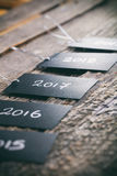 Pricing tags in a row with. 2017 focus and other years text on wooden background Royalty Free Stock Photo